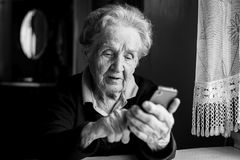Elderly woman typing on the smartphone. Education. royalty free stock photo