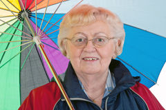 Elderly woman with umbrella Stock Photos