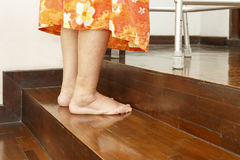 Elderly woman up stairs with walker Stock Photo