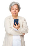 Elderly woman use of cellphone Royalty Free Stock Photo