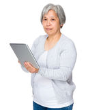 Elderly woman use of digital tablet Royalty Free Stock Photography