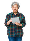 Elderly woman use of tablet Royalty Free Stock Image