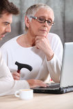 Elderly woman using a computer royalty free stock photography