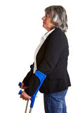 Elderly woman using crutches Royalty Free Stock Photo