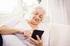 Elderly woman using her smartphone Stock Photo