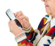 Elderly woman using smartphone Royalty Free Stock Images