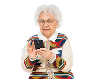 Elderly woman using smartphone Stock Photos