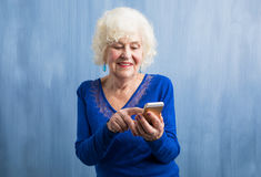 An elderly woman using smartphone stock photography