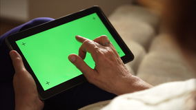 Elderly woman using a tablet PC with green screen. Elderly woman using a digital tablet PC with green screen, back view stock video