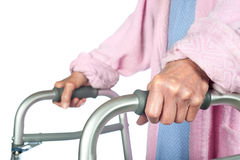 Elderly woman using walker Stock Images