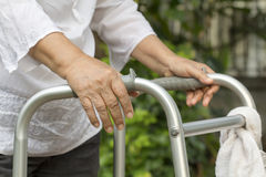 Elderly woman using a walker Royalty Free Stock Images