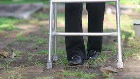Elderly woman using walker in backyard . stock video footage
