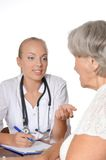 Elderly woman visiting doctor Stock Photos
