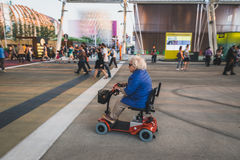 Elderly woman visiting Expo 2015 in Milan, Italy Stock Images