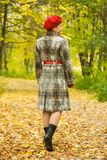 Elderly woman walking  in autumn Royalty Free Stock Images
