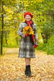 Elderly woman walking  in autumn Stock Photo