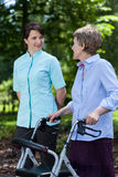 Elderly woman walking with a walker Royalty Free Stock Photos