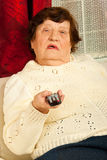 Elderly woman watch tv stock photography