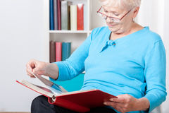 Elderly woman watching photos Stock Photo