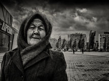 09/10/2015 - An elderly woman wearing a home-knitted woolen shawl and hat Royalty Free Stock Image