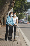 Elderly woman wearing mask for protect air pollution Stock Photos