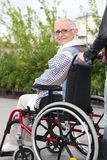 Elderly woman in wheelchair Stock Photos