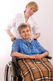 Elderly woman in wheelchair royalty free stock photo