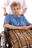 Elderly woman in wheelchair Stock Image
