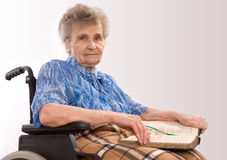 Elderly woman in wheelchair Royalty Free Stock Photography