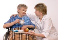 Elderly woman in wheelchair Royalty Free Stock Photo