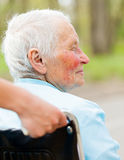 Elderly Woman In Wheelchair Outdoors Stock Photo