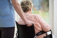 Elderly woman on wheelchair Stock Photo