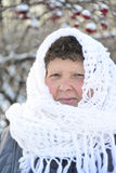 Elderly woman in  white knitted shawl costs about Royalty Free Stock Photos