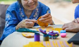 Free Elderly Woman With Caregiver In The Needle Crafts Occupational Therapy  For Alzheimer's Or Dementia Royalty Free Stock Photo - 189897375
