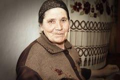 Elderly woman at work royalty free stock photo