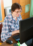 Elderly woman working with computer Royalty Free Stock Photo