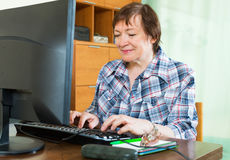 Elderly woman working with computer Royalty Free Stock Image