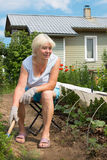 Elderly woman working in the garden Stock Photo