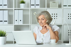 Elderly woman working on laptop Royalty Free Stock Photo