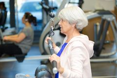 Elderly woman working out in gym Royalty Free Stock Images