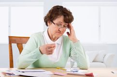 Elderly woman worry about bill notice Royalty Free Stock Photo