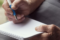 Elderly woman writing Royalty Free Stock Photography