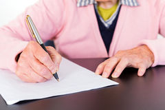 Elderly woman writing Royalty Free Stock Image