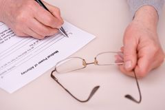 Elderly woman writing testament Stock Image