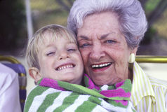 Elderly woman and young boy Stock Photo