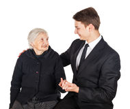 Elderly woman and young businessman Stock Photos