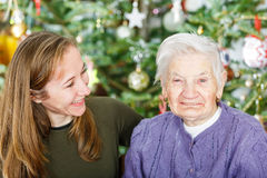 Elderly woman and young carer Royalty Free Stock Photo
