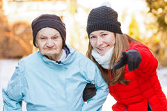 Elderly woman and young carer Stock Image