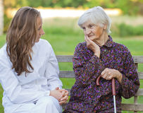 Elderly woman with the young doctor Royalty Free Stock Photos