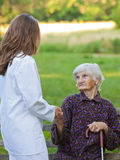 Elderly woman with the young doctor Stock Photo